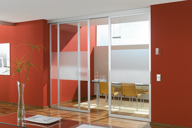 Glass walls and partitions sakla klari take advantage of glass partitions to simultaneously separate and merge the rooms planetlyrics Choice Image